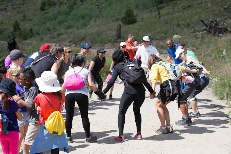 Family members celebrate after reaching the peak of a hike in the Keystone Resort at Keystone, Colorado, Saturday, Aug. 13, 2016. The 50th Space Wing Chapel Office sponsored the retreat to give families a chance to focus on bonding. (Courtesy photo)