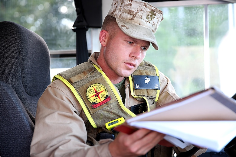 Cpl. Eric A. Fox a rifleman with the reaction platoon and bus driver for Initial Response Force B, or IRF B, with Chemical Biological Incident Response Force, CBIRF, reviews the given route book during a deployment drill in preparation for the Republican National Convention, RNC, in Cleveland, July 17, 2016.  CBIRF's Marines and sailors worked alongside federal and local agencies to provide chemical, biological, radiological, nuclear and high-yield explosives, CBRNE, response capability for the Republican and Democratic National Conventions. CBIRF is an active duty Marine Corps unit that, when directed, forward-deploys and/or responds with minimal warning to a chemical, biological, radiological, nuclear or high-yield explosive (CBRNE) threat or event in order to assist local, state, or federal agencies and the geographic combatant commanders in the conduct of CBRNE response or consequence management operations, providing capabilities for command and control; agent detection and identification; search, rescue, and decontamination; and emergency medical care for contaminated personnel.  (Official USMC Photo by Lance Cpl. Maverick S. Mejia/RELEASED)