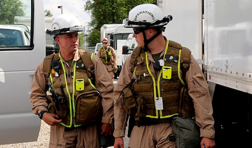 Sgt. Brian T. Brown, right, Initial Response Force, or IRF, operations chief, and Staff Sgt. Kevin W. Brown, left, staff noncommissioned officer in charge for IRF B, Chemical Biological Incident Response Force, CBIRF, discuss plans in preparation for the Republican National Convention, RNC, in Cleveland, July 18, 2016.