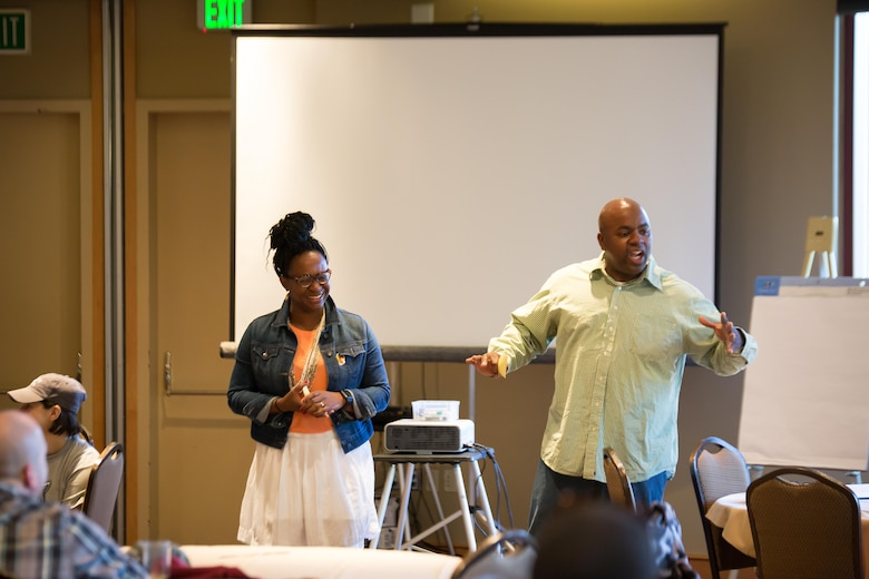 Maj. LaToya Smith and Chief Master Sgt. Peter Smith speak during a resiliency session as part of a family retreat at Keystone, Colorado, Saturday, Aug. 13, 2016. The 50th Space Wing Chapel Office sponsored the event and asked the Smiths to speak to attendees and share their experiences as a military family. (Courtesy photo)