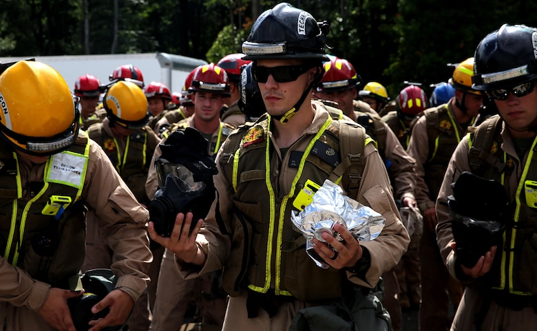 Marines with Chemical Biological Incident Response Force, CBIRF, inspect their M53 gas mask and sealed filters in preparation for the Republican National Convention, RNC, in Cleveland, July 18, 2016. CBIRF's Marines and sailors worked alongside federal and local agencies to provide chemical, biological, radiological, nuclear and high-yield explosives, CBRNE, response capability for the Republican and Democratic National Conventions. CBIRF is an active duty Marine Corps unit that, when directed, forward-deploys and/or responds with minimal warning t o a chemical, biological, radiological, nuclear or high-yield explosive (CBRNE) threat or event in order to assist local, state, or federal agencies and the geographic combatant commanders in the conduct of CBRNE response or consequence management operations, providing capabilities for command and control; agent detection and identification; search, rescue, and decontamination; and emergency medical care for contaminated personnel. (Official USMC Photo by Lance Cpl. Maverick S. Mejia/RELEASED)