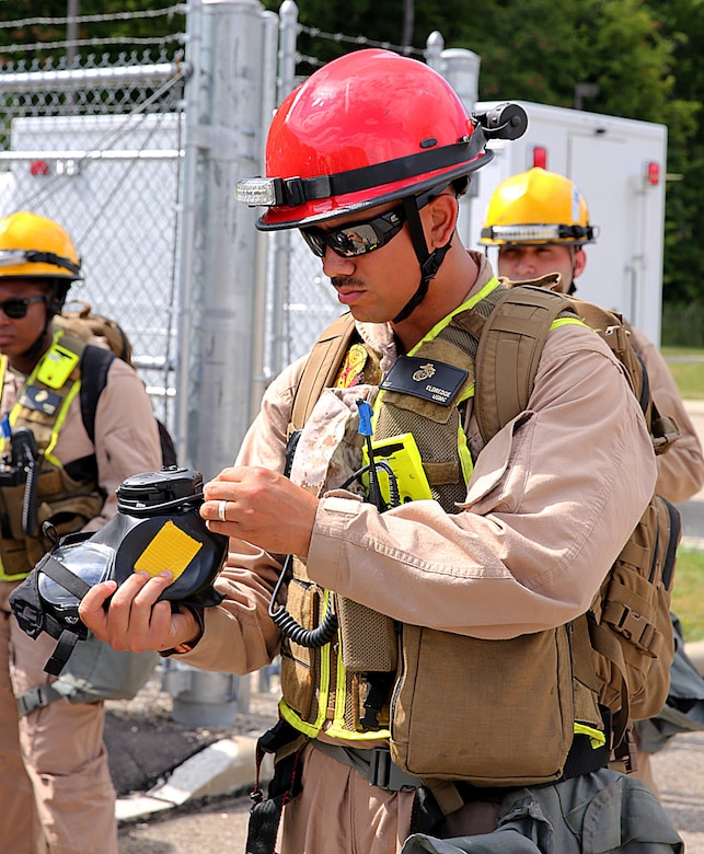 Sgt. Alfred Eldredge, a motor vehicle operator with Chemical Biological Incident Response Force, CBIRF, inspects his M53 gas mask for any damages in preparation for the Republican National Convention, RNC, in Cleveland, July 18, 2016. CBIRF's Marines and sailors worked alongside federal and local agencies to provide chemical, biological, radiological, nuclear and high-yield explosives, CBRNE, response capability for the Republican and Democratic National Conventions. CBIRF is an active duty Marine Corps unit that, when directed, forward-deploys and/or responds with minimal warning t o a chemical, biological, radiological, nuclear or high-yield explosive (CBRNE) threat or event in order to assist local, state, or federal agencies and the geographic combatant commanders in the conduct of CBRNE response or consequence management operations, providing capabilities for command and control; agent detection and identification; search, rescue, and decontamination; and emergency medical care for contaminated personnel. (Official USMC Photo by Lance Cpl. Maverick S. Mejia/RELEASED)