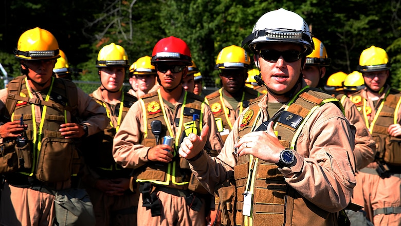 Sgt. Brian T. Brown, IRF operations chief, for Initial Response Force, IRF, Bravo, Chemical Biological Incident Response Force, CBIRF, speaks to Marines and sailors after a deployment drill during the Republican National Convention, RNC, in Cleveland, July 19, 2016. CBIRF's Marines and sailors worked alongside federal and local agencies to provide chemical, biological, radiological, nuclear and high-yield explosives, CBRNE, response capability for the Republican and Democratic National Conventions. CBIRF is an active duty Marine Corps unit that, when directed, forward-deploys and/or responds with minimal warning t o a chemical, biological, radiological, nuclear or high-yield explosive (CBRNE) threat or event in order to assist local, state, or federal agencies and the geographic combatant commanders in the conduct of CBRNE response or consequence management operations, providing capabilities for command and control; agent detection and identification; search, rescue, and decontamination; and emergency medical care for contaminated personnel. (Official USMC Photo by Lance Cpl. Maverick S. Mejia/RELEASED)