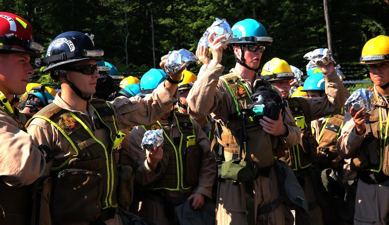Marines with Chemical Biological Incident Response Force, CBIRF, hold their sealed filters during a gear inspection in preparation for the Republican National Convention, RNC, in Cleveland, July 19, 2016. CBIRF's Marines and sailors worked alongside federal and local agencies to provide chemical, biological, radiological, nuclear and high-yield explosives, CBRNE, response capability for the Republican and Democratic National Conventions. CBIRF is an active duty Marine Corps unit that, when directed, forward-deploys and/or responds with minimal warning t o a chemical, biological, radiological, nuclear or high-yield explosive (CBRNE) threat or event in order to assist local, state, or federal agencies and the geographic combatant commanders in the conduct of CBRNE response or consequence management operations, providing capabilities for command and control; agent detection and identification; search, rescue, and decontamination; and emergency medical care for contaminated personnel. (Official USMC Photo by Lance Cpl. Maverick S. Mejia/RELEASED)
