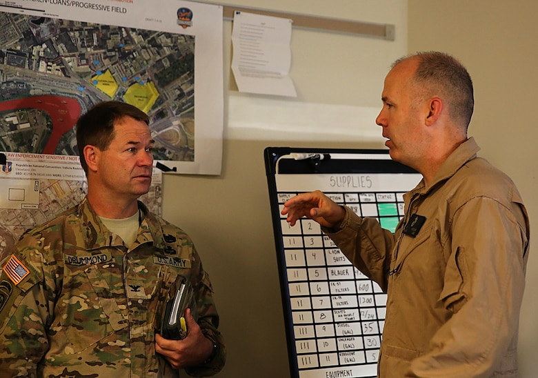 Col. Frederic A. Drummond, left, Army colonel with JTF-Shield, meets with Marine Lt. Col. Shaun T. Fitzpatrick, right, executive officer of Chemical Biological Incident Response Force, CBIRF, and mission commander for Initial Response Force B, with CBIRF, discuss plans in preparation for the Republican National Convention, RNC, in Cleveland, July 20, 2016.  CBIRF's Marines and sailors worked alongside federal and local agencies to provide chemical, biological, radiological, nuclear and high-yield explosives, CBRNE, response capability for the Republican and Democratic National Conventions. CBIRF is an active duty Marine Corps unit that, when directed, forward-deploys and/or responds with minimal warning to a chemical, biological, radiological, nuclear or high-yield explosive (CBRNE) threat or event in order to assist local, state, or federal agencies and the geographic combatant commanders in the conduct of CBRNE response or consequence management operations, providing capabilities for command and control; agent detection and identification; search, rescue, and decontamination; and emergency medical care for contaminated personnel.  (Official USMC Photo by Lance Cpl. Maverick S. Mejia/RELEASED)