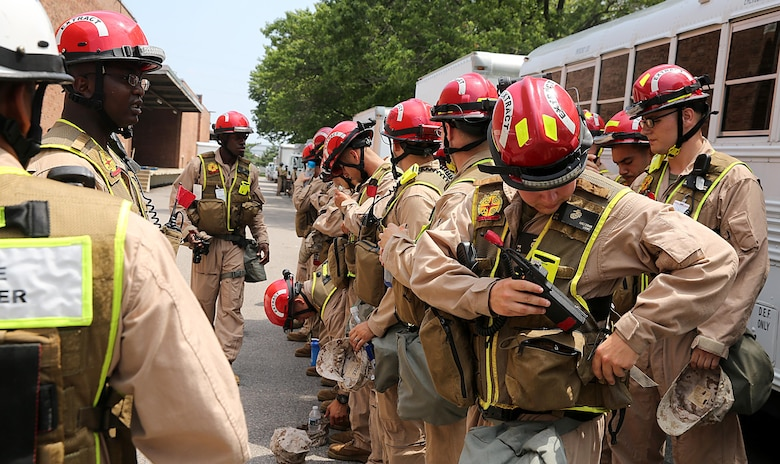 Marines from the search and extraction platoon, Chemical Biological Incident Response Force, CBIRF line up for accountability after a deployment drill during Democratic National Convention, DNC, in Philadelphia, July 25, 2016. CBIRF's Marines and sailors worked alongside federal and local agencies to provide chemical, biological, radiological, nuclear and high-yield explosives, CBRNE, response capability for the Republican and Democratic National Conventions. CBIRF is an active duty Marine Corps unit that, when directed, forward-deploys and/or responds with minimal warning t o a chemical, biological, radiological, nuclear or high-yield explosive (CBRNE) threat or event in order to assist local, state, or federal agencies and the geographic combatant commanders in the conduct of CBRNE response or consequence management operations, providing capabilities for command and control; agent detection and identification; search, rescue, and decontamination; and emergency medical care for contaminated personnel. (Official USMC Photo by Lance Cpl. Maverick S. Mejia/RELEASED)