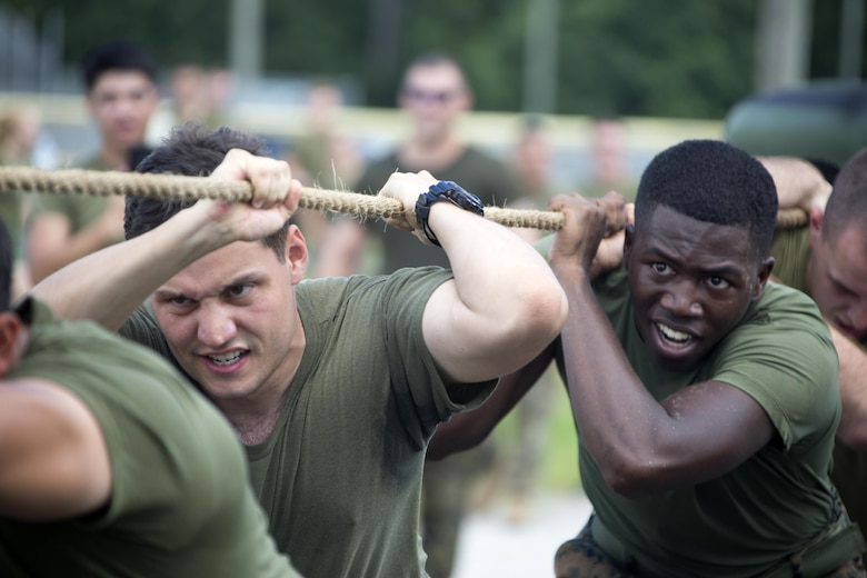 Marines participate in a 7-ton-pull during the 75th anniversary field meet competition at Marine Corps Air Station Cherry Point, N.C., Aug. 12, 2016. Headquarters and Headquarters Squadron, Marine Corps Air Station Cherry Point, and Marine Wing Headquarters Squadron 2, 2nd Marine Aircraft Wing, Marines of all ranks and ages came together to compete in numerous events testing their strength, teamwork and unit spirit. Some of the events the competitors participated in include: an all ranks relay, rifle relay race, unit soccer, a 7-ton pull and more. (U.S. Marine Corps photo by Cpl. N.W. Huertas/Released)