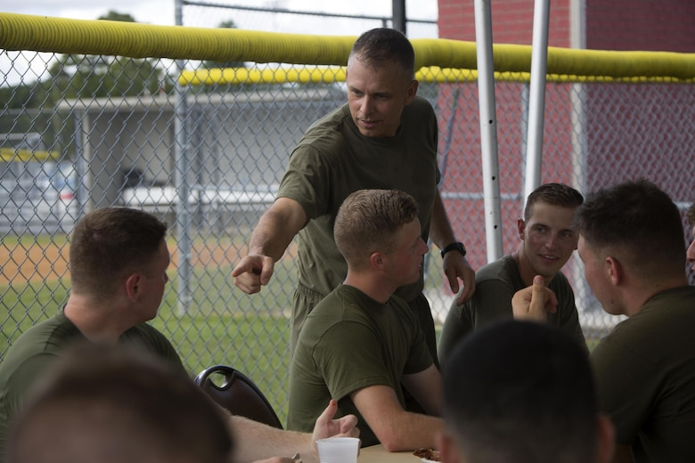 Brig. Gen Matthew G. Glavy interacts with Marines during the 75th anniversary field meet competition at Marine Corps Air Station Cherry Point, N.C., Aug. 12, 2016. Headquarters and Headquarters Squadron, Marine Corps Air Station Cherry Point, and Marine Wing Headquarters Squadron 2, 2nd Marine Aircraft Wing, Marines of all ranks and ages came together to compete in numerous events testing their strength, teamwork and unit spirit. Some of the events the competitors participated in include: an all ranks relay, rifle relay race, unit soccer, a 7-ton pull and more. Glavy is the commanding general for 2nd MAW. (U.S. Marine Corps photo by Cpl. N.W. Huertas/Released)