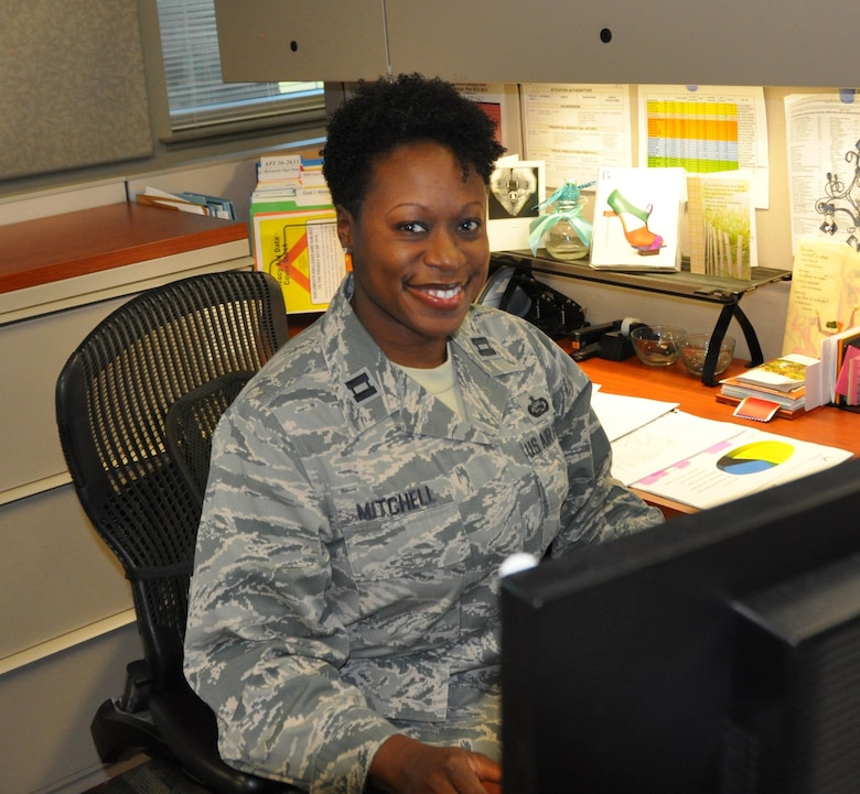 Capt. Avril Mitchell, assigned to the Air Reserve Personnel Center Pre-Trained Individual Manpower Management Division, was awarded the Personnel Reserve Component Company Grade Officer of the Year award. The Air Force-level award was for her work supporting wartime efforts through securing sustainable mobilization assets, codification of the ARPC Mobility Plan and execution of the Air Force's only face-to-face screening activity. (U.S. Air Force photo by Tech. Sgt. Beth Anschutz)