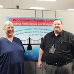 Defense Logistics Agency Aviation Procurement Analysts Beth Lamothe and Richard Bullock pose for a photo Aug. 9, 2016 on Defense Supply Center Richmond, Virginia.  Lamothe and Bullock serve as DLA Aviation's font line in fraud monitoring.