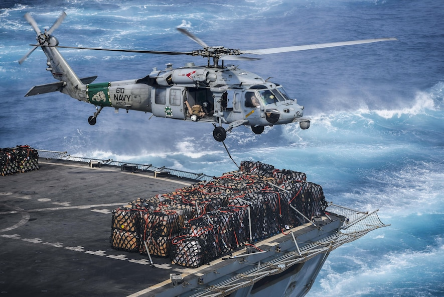 An MH-60S Seahawk helicopter prepares to deliver cargo to the flight deck
