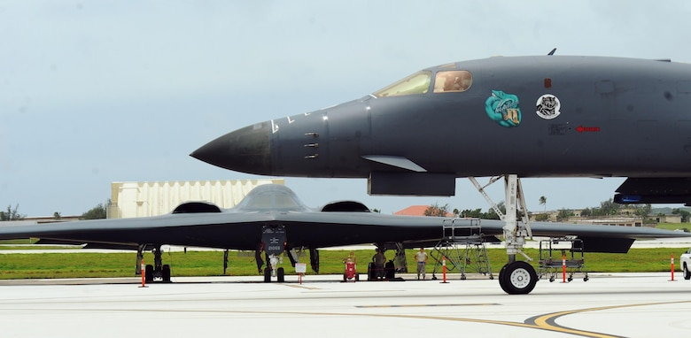 A U.S. Air Force B-1 Lancer deployed from Ellsworth Air Force Base, S.D., taxis in front of a B-2 Spirit, deployed from Whiteman Air Force Base, Mo., at Andersen Air Force Base, Guam, Aug. 15, 2016. The Continuous Bomber Presence is vital to our combat capability because it mitigates the geographical challenges of distance that are unique to the Pacific. (U.S. Air Force photo by Senior Airman Jovan Banks)