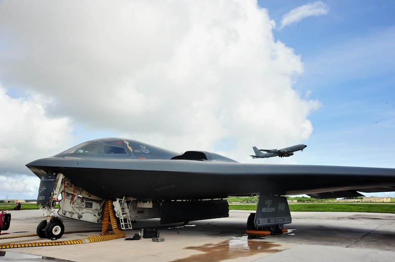 A U.S. Air Force B -2 Spirit aircraft deployed from Whiteman Air Force Base, Mo., undergoes flight preparations as a KC-135 Stratotanker takes flight at Andersen Air Force Base, Guam, Aug. 15, 2016. The U.S. routinely and visibly demonstrates its commitment to its allies and partners through the global operations of our military forces. (U.S. Air Force photo by Senior Airman Jovan Banks)