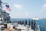 Sailors aboard the Arleigh Burke-class guided-missile destroyer USS Benfold (DDG 65) man the rails before the ship breaks away from the People's Liberation Army (Navy) Jiangkai II class frigate Daqing (FFG 576) during a Code for Unplanned Encounters at Sea exercise, Aug. 12, 2016. Benfold is currently underway in the the Western Pacific  in support of security and stability in the Indo-Asia Pacific region.