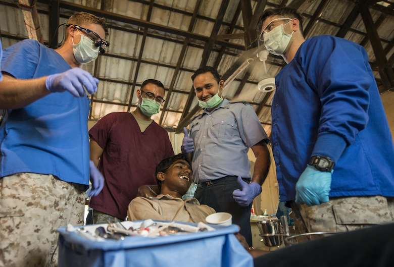Members from the U.S. Navy, U.S. Air Force and Sri Lankan Air Force smile after a tooth extraction during Pacific Angel (PACANGEL) 16-3 in Jaffna, Sri Lanka, Aug. 16, 2016. Operation PACANGEL 16 is a joint and combined humanitarian assistance operation. Led by Pacific Air Forces, the exercise enhances participating nations' humanitarian assistance and disaster relief (HA/DR) capabilities while providing needed services to people in need throughout Southeast Asia. (U.S. Air Force photo by Senior Airman Brittany A. Chase)