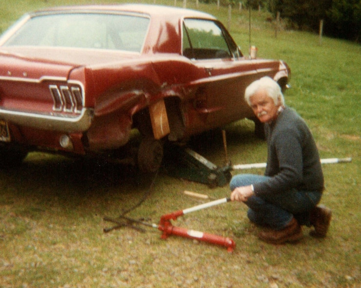 George G. Shaw poses for a photo while repairing the courter panel on a 1967 Ford mustang, 1988, at his home in Arcata, Calif. Shaw built the mustang for his daughter as her first car, and the vehicle was later passed on to his granddaughter. (Courtesy photo)