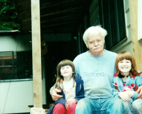 George G. Shaw, center, poses for a photo with his granddaughters Jenna K. Caldwell left and Megan E. Caldwell on the back porch steps of their house, 2001, in Arcata, Calif. (Courtesy photo)