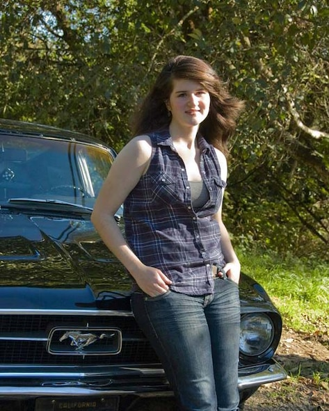 Jenna K. Caldwell poses for a photo in front of a Ford mustang, Nov. 2013, at her home in Arcata, Calif. The mustang, a 1967 fastback, belonged to her grandfather and a similar vehicle to her first car, a 1967 Ford mustang coupe. (Courtesy photo)