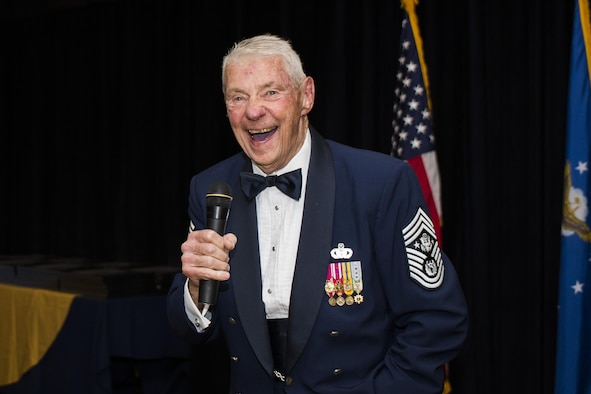 Retired U.S. Air Force Chief Master Sgt. Robert D. Gaylor, fifth Chief Master Sergeant of the Air Force, laughs while speaking at a senior NCO induction ceremony during his visit to Cannon Air Force Base, N.M., Aug. 11, 2016. Gaylor acted as the guest speaker and provided newly selected master sergeants with guidance on the next step in their career. (U.S. Air Force photo by Senior Airman Luke Kitterman/Released)