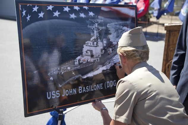 U.S. Navy Vice Adm. Nora W. Tyson, Commander, U.S. 3rd Fleet signs the graphic of the USS John Basilone after the ship naming ceremony for the USS John Basilone (DDG-122) on Camp Pendleton, Calif., August 16, 2016. (U.S. Marine Corps photo by Cpl. Tyler S. Dietrich)