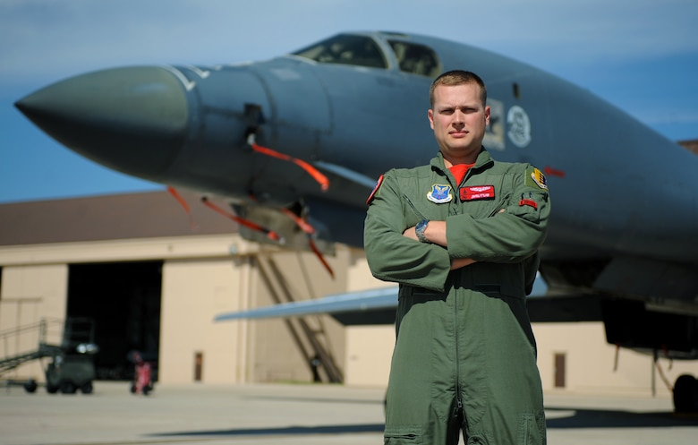 Captain Aaron Tindall, a weapons system officer assigned to the 34th Bomb Squadron, poses in front of a B-1 bomber at Ellsworth Air Force Base, S.D., August 5, 2016. Tindall was the only officer from Ellsworth selected to participate in a joint training program with the U.S. Navy EA-18G Growlers, focusing on electronic warfare. (U.S. Air Force photo by Airman 1st Class Denise M. Jenson)