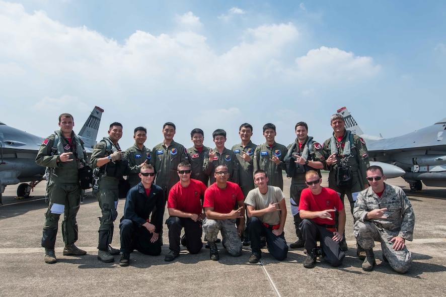 Members of the 51st Fighter Wing and Republic of Korea air force's 11th Fighter Wing pose for a photo before the last flying training mission of Buddy Wing 16-7 at Daegu Air Base, Republic of Korea, Aug. 12, 2016. This Buddy Wing served as a precursor to October's RED FLAG-Alaska, a Pacific Air Forces exercise that provides joint offensive counter-air, interdiction, close air support and large force employment training in a simulated combat environment. (U.S. Air Force photo by Senior Airman Dillian Bamman)