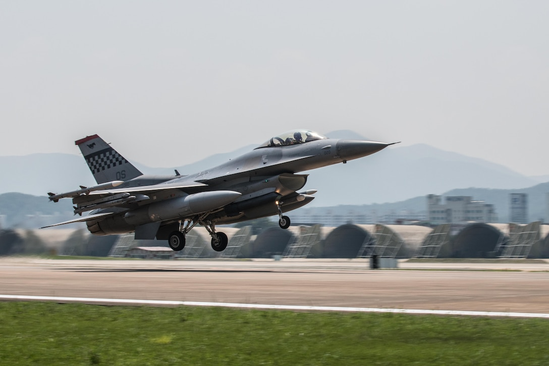 An F-16 Fighting Falcon takes off for Daegu's airspace during Buddy Wing 16-7 at Daegu Air Base, Republic of Korea, Aug. 12, 2016. The Buddy Wing program is a 7th Air Force initiative to foster and maintain close ties and interoperability between the U.S. ROK air forces by training and flying combined missions. (U.S. Air Force photo by Senior Airman Dillian Bamman)