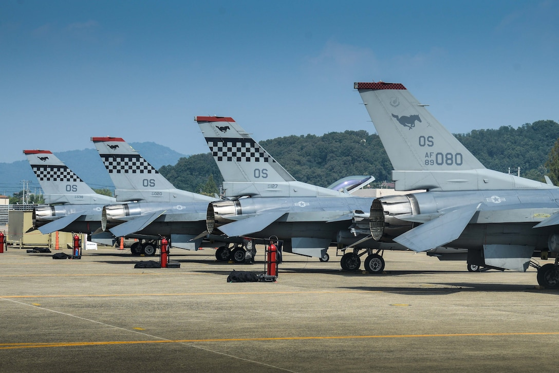 F-16 Fighting Falcons from the 36th Fighter Squadron rest on the flightline for preflight inspections during Buddy Wing 16-7 at Daegu Air Base, Republic of Korea, Aug. 12, 2016. The Buddy Wing program is a 7th Air Force initiative to foster and maintain close ties and interoperability between the U.S. ROK air forces by training and flying combined missions. (U.S. Air Force photo by Senior Airman Dillian Bamman)
