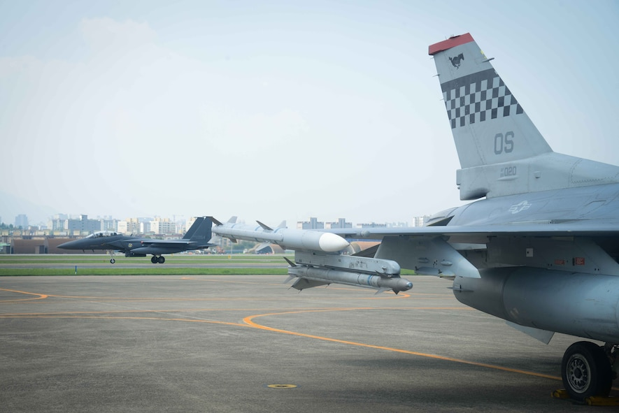 An F-15K Slam Eagle from the Republic of Korea air force's 11th Fighter Wing taxis on the flightline before a flying training mission for Buddy Wing 16-7 at Daegu Air Base, ROK, Aug. 12, 2016. Members participating in Buddy Wing train to build relationships and broaden their knowledge of working in a joint environment with combined operations aimed at deterring enemy aggression. (U.S. Air Force photo by Senior Airman Dillian Bamman)