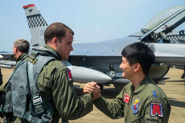 Capt. Ryan Pebler, 36th Fighter Squadron F-16 Fighting Falcon pilot, shakes hands with Republic of Korea air force Capt. Chon, Hun Min, 11th Fighter Wing F-15K Slam Eagle pilot, before takeoff during Buddy Wing 16-7 at Daegu Air Base, ROK, Aug. 12, 2016. In October, both Pebler and Chon will be participating in RED FLAG-Alaska, a Pacific Air Forces exercise that provides joint offensive counter-air, interdiction, close air support and large force employment training in a simulated combat environment. (U.S. Air Force photo by Senior Airman Dillian Bamman)