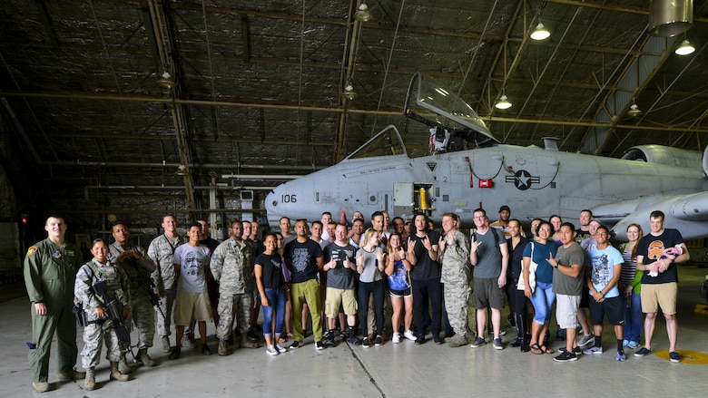 "Members of Team Osan pose with the actors and crew members of ""Lobby Hero"" in front of an A-10 Thunderbolt II during a visit to Osan Air Base, Republic of Korea, Aug. 13, 2016. The cast and crew visited a maintenance hangar and the A-10 flight simulator prior to the play to gain an understanding of the Team Osan mission. (U.S. Air Force photo by Senior Airman Victor J. Caputo/Released)"
