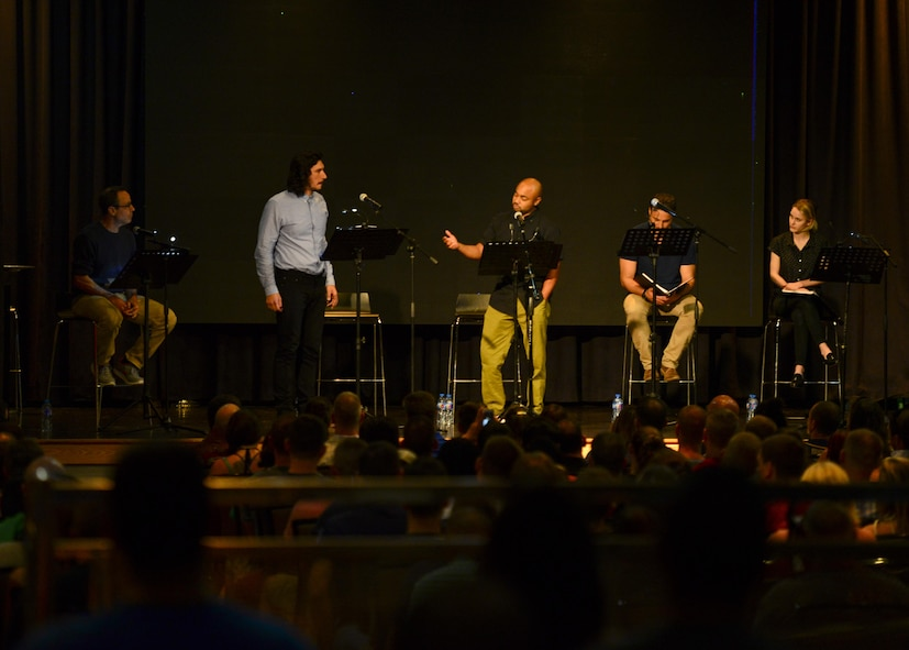 """Director Stephen Belber, and actors Adam Driver, Francois Battiste, Dominic Fumusa, and Rachel Brosnahan perform a reading of the play """"Lobby Hero"""" in the Enlisted Club at Osan Air Base, Republic of Korea, Aug. 13, 2016. The play reading was sponsored by Arts in the Armed Forces, a non-profit organization founded by Driver to bring free theater performances to military members. (U.S. Air Force photo by Senior Airman Victor J. Caputo/Released)"""