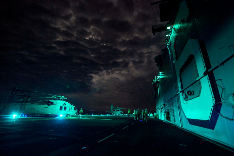 Navy sailors conduct flight operations with MH-60S Sea Hawks assigned to Helicopter Sea Combat Squadron 25 aboard amphibious assault ship USS Bonhomme Richard in the East China Sea, Aug. 12, 2016. The Bonhomme Richard, flagship of the Bonhomme Richard Expeditionary Strike Group, is operating in the U.S. 7th Fleet area of operations in support of security and stability in the Indo-Asia-Pacific region. Navy photo by Petty Officer 3rd Class Jeanette Mullinax