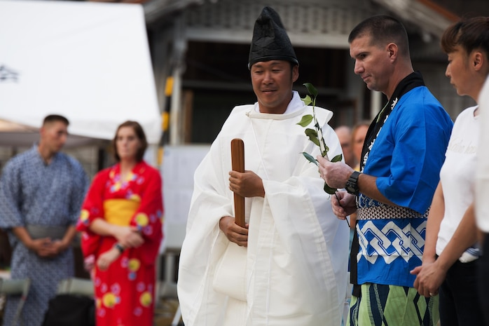 U.S. Marine Corps Chief Warrant Officer Marcus Major, chemical biological radiological nuclear defense officer for Marine Aircraft Group 12, prepares to honor the Shiroyama Hime Shrine during the Bon-Odori Yukata-Experience festival in the Yokoyama area of Iwakuni, Japan, Aug. 13, 2016. Major was invited by the locals to join the honoring of the Shiroyama Hime shrine and said it was an honor to have been part of the ceremony. (U.S. Marine Corps photo by Lance Cpl. Joseph Abrego)
