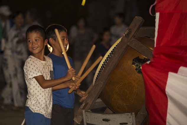 Local children play a drum during the Bon-Odori Yukata-Experience festival in the Yokoyama area of Iwakuni, Japan, Aug. 13, 2016. Locals and residents from Marine Corps Air Station Iwakuni danced to the singing of elders and the steady beat of drums. (U.S. Marine Corps photo by Lance Cpl. Joseph Abrego)