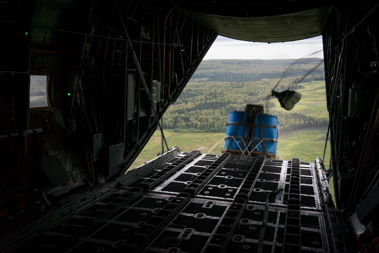 A container delivery system bundle drops from a C-130 Hercules during Red Flag Alaska on Joint Base Elmendorf-Richardson, Alaska, Aug. 12, 2016. Instead of being pushed out of the plane by a loadmaster, cds bundles are ejected using only the forward momentum of the aircraft. (U.S. Air Force photo by Staff Sgt. Michael Smith/Released)