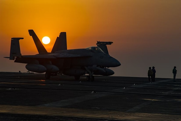 A Navy F/A-18E Super Hornet assigned to Strike Fighter Squadron 105 taxies across the flight deck of the aircraft carrier USS Dwight D. Eisenhower in the Persian Gulf, July 31, 2016. Navy photo by Petty Officer 3rd Class Nathan Beard