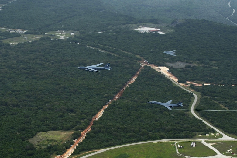 A U.S. Air Force B-52 Stratofortress, B-1 Lancer and B-2 Spirit fly over Guam after launching from Andersen Air Force Base, Guam, for an integrated bomber operation Aug.17, 2016. This mission marks the first time in history that all three of Air Force Global Strike Command's strategic bomber aircraft are simultaneously conducting integrated operations in the U.S. Pacific Command area of operations. As of Aug. 15, the B-1 Lancer will be temporarily deployed to Guam in support of U.S. Pacific Command's Continuous Bomber Presence mission. (U.S. Air Force photo by Staff Sgt. Sandra Welch)