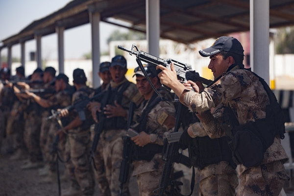 Iraqi Counter Terrorism Service  soldiers perform reloading drills with their M-4 rifles during refit training near Baghdad, Iraq, July 13, 2016. Refit is the period of time between missions that counterterrorism service soldiers use for additional training and equipment maintenance. This training is critical to enabling Iraqi security forces counter ISIL as they work to regain territory from the terrorist group. (U.S. Army photo by Staff Sgt. Sergio Rangel/RELEASED)