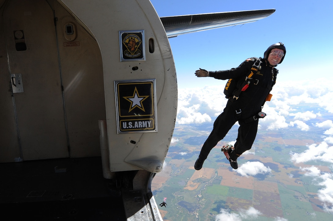 A member of the U.S. Army Golden Knights jumps out of a plane at the Northern Neighbors Day Air Show at Minot Air Force Base, N.D., Aug. 13, 2016. The team performs parachute demonstrations at air shows, major league football and baseball games, and other special events, connecting the Army with the American people. (U.S. Air Force photo/Senior Airman Kristoffer Kaubisch)