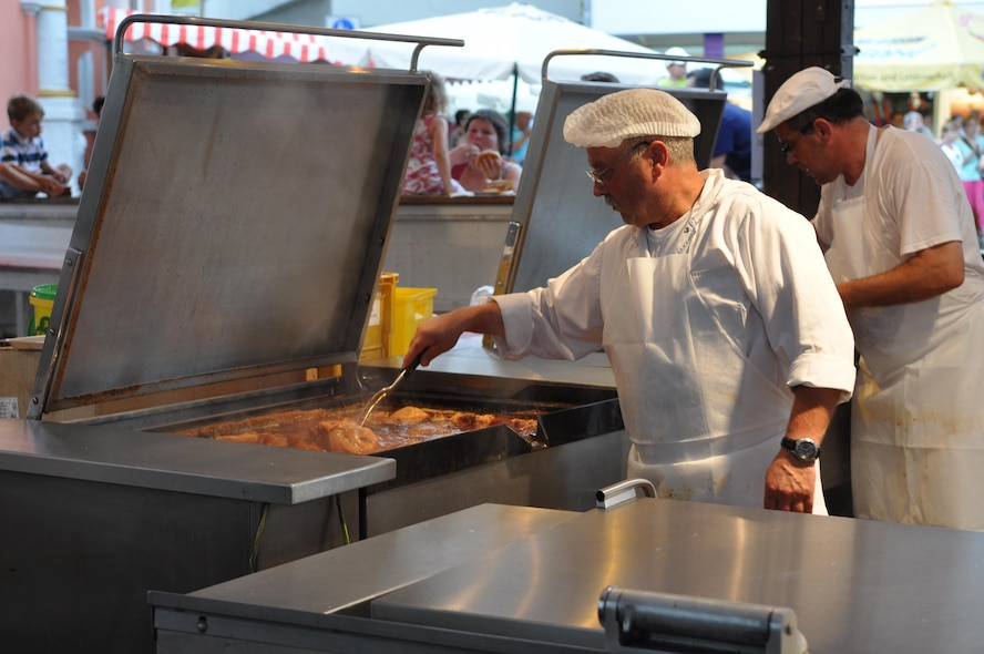 "A cook prepares a roasting pig during the annual Pig Burner's festival in Wittlich, Germany, Aug. 12, 2012. More than 200 pigs are sold annually at the popular ""Saeubrenner Kirmes"" in Wittlich, an event that attracts thousands of visitors from Germany and various other countries. (U.S. Air Force photo by Iris Reiff/Released)"