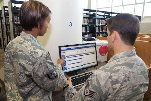 Technical Sgt. Tia Strong and Staff Sgt. Andrew Daily, instructors with the United States Air Force School of Aerospace Medicine's Department of Occupational & Environmental Health, navigate Blackboard, the commercially-hosted Learning Management System the School has contracted with to modernize its training platforms. (U.S. Air Force photo/David W. Snedigar)