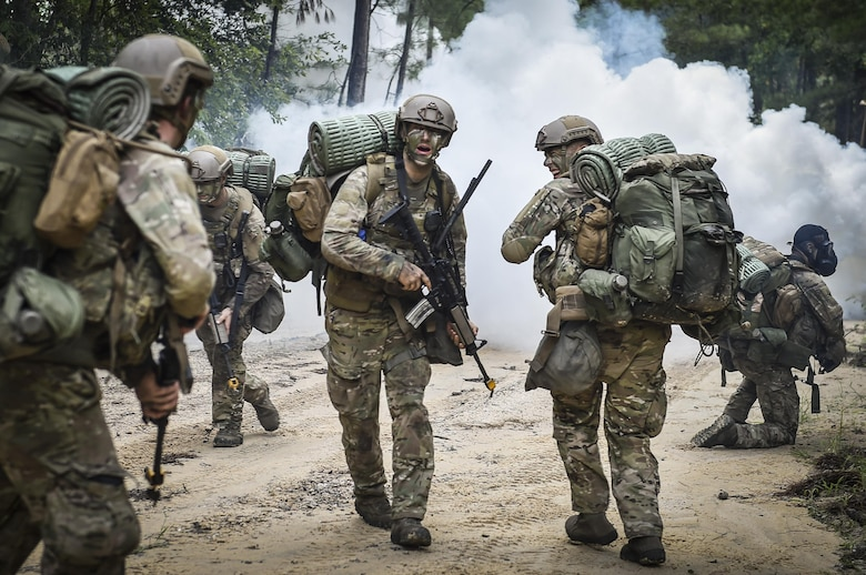 Combat Control School students assigned to the 352nd Battlefield Airman Training Squadron are ambushed at their drop-off point during a tactics field training exercise at Camp Mackall, N.C., Aug. 3, 2016. The FTX is a culmination of tactics learned in the first year of the CCT pipeline; which entails weapons handling, team leader procedures, patrol base operations, troop leading and small unit tactics under fire in one mission. (U.S. Air Force photo by Senior Airman Ryan Conroy)