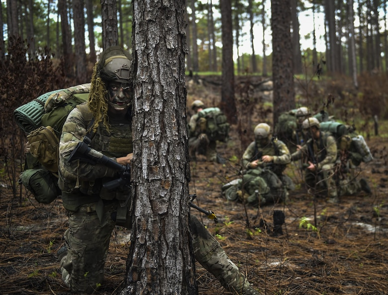 A 352nd Battlefield Airman Training Squadron Combat Control School student scans the woods as rear security for his unit during a tactics field training exercise at Camp Mackall, N.C., Aug. 3, 2016. The FTX is a culmination of tactics learned in the first year of the CCT pipeline; which entails weapons handling, team leader procedures, patrol base operations, troop leading and small unit tactics under fire in one mission. (U.S. Air Force photo by Senior Airman Ryan Conroy)