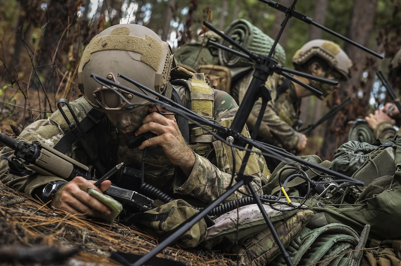 A 352nd Battlefield Airmen Training Squadron Combat Control School student radios to a simulated aircraft during a tactics field training exercise at Camp Mackall, N.C., Aug. 3, 2016. The 352nd BATS, or Combat Control School, is the home of a 13-week course that provides initial CCT qualifications. The training includes, small unit tactics, land navigation, communications, assault zones, physical training demolitions, fire support and field operations including parachuting. At the completion of this course, each graduate is awarded the three-skill level, scarlet beret and CCT flash. (U.S. Air Force photo by Senior Airman Ryan Conroy)