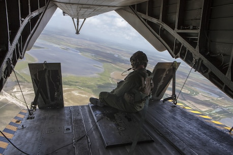 Staff Sgt. Steven Vanarsdale, a crew chief with Marine Heavy Helicopter Squadron 772, Special Purpose Marine Air-Ground Task Force - Southern Command, rides on the ramp of a CH-53E Super Stallion helicopter during a flight to Soto Cano Air Base, Honduras, June 13, 2016. During their deployment, SPMAGTF-SC Marines and sailors will work and train alongside their counterparts in Honduras, El Salvador, Guatemala, and Belize and be on standby to provide humanitarian assistance and disaster relief in case of a major disaster. (U.S. Marine Corps photo by Sgt. Adwin Esters/Released)