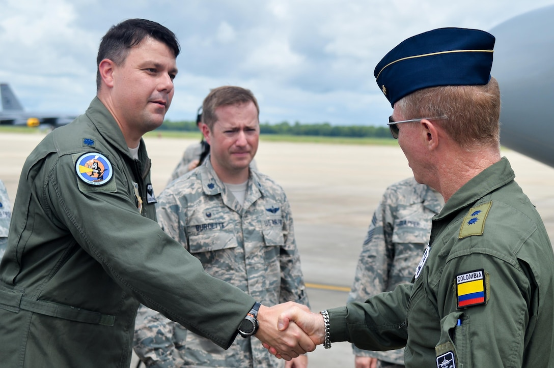 Lt. Col. Jason Attaway, 548th Combat Training Squadron, Detachment 1 commander, greets Colombian Air Force Brig. Gen. Rodrigo Alejandro Valencia Guevara upon his arrival to Barksdale Air Force Base, La., Aug. 13, 2016. The Colombians are participating in Exercise Green Flag East, which is administered by the 548th CTS detachment. (U.S. Air Force photo/Senior Airman Mozer O. Da Cunha)