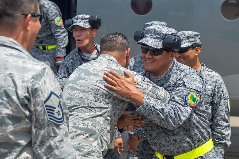 Colombian and U.S. Air Force Airmen greet each other after the Colombians arrived to Barksdale Air Force Base, La., Aug. 13, 2016. The Colombian Airmen, along with four A-29B Super Tucano aircraft, are at Barksdale to participate in Exercise Green Flag East Aug. 15-29. (U.S. Air Force photo/Senior Airman Mozer O. Da Cunha)