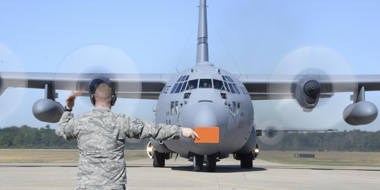 Staff Sgt. Michael Pike, 921st Contingency Response Squadron aero maintenance craftsman, marshals a C-130 Hercules during  Exercise Northern Strike at Grayling Army Airfield, Michigan, Aug. 8, 2016. Exercise Northern Strike is a large-scale exercise coordinated by the Michigan Army National Guard and features Army, Marines and Air Force working together for total force integration. (U.S. Air Force photo by Senior Airman Amber Carter)