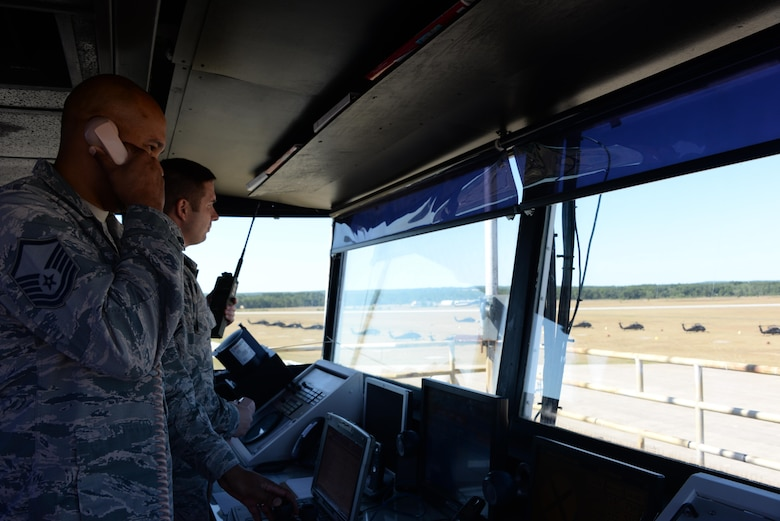 Master Sgt. Greylynn Carr and Master Sgt. Bradley Rich, 821st Contingency Response Squadron air traffic control craftsmen, watch the skies and the flightline from the tower at Grayling Army Airfield, Michigan, Aug. 8, 2016. Both Carr and Rich are stationed at Travis Air Force Base, California, and were in Michigan as part of Exercise Northern Strike. Exercise Northern Strike is a large-scale exercise coordinated by the Michigan Army National Guard and features Army, Marines and Air Force working together for total force integration. (U.S. Air Force photo by Senior Airman Amber Carter)